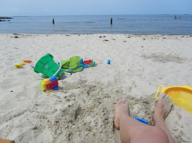 Gone are the days of just one bag and a small cooler...beach toys for days!